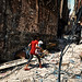 A girl runs away to save her life and her doll in the street of Mosul by rvjak