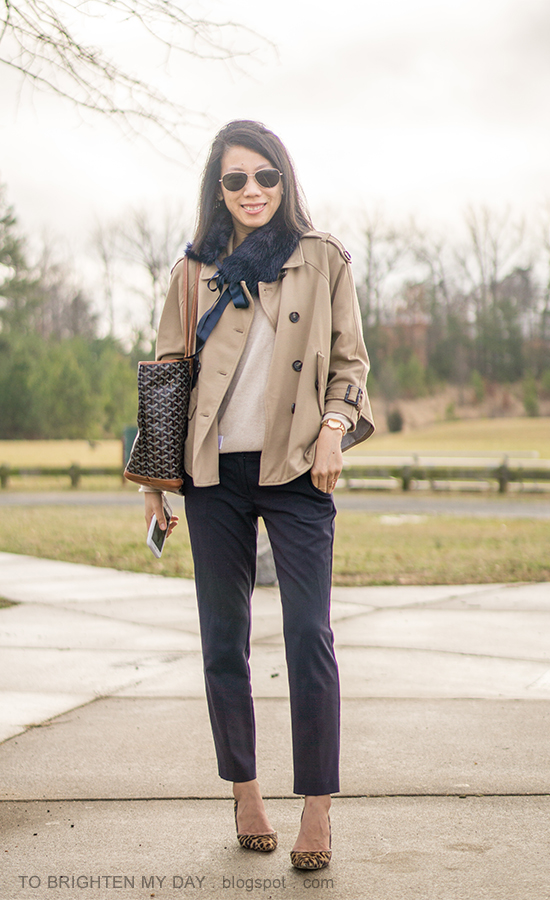 navy faux fur scarf with ribbon tie, camel trench cape jacket, camel sweater, gold watch, navy pants, printed tote, leopard pumps
