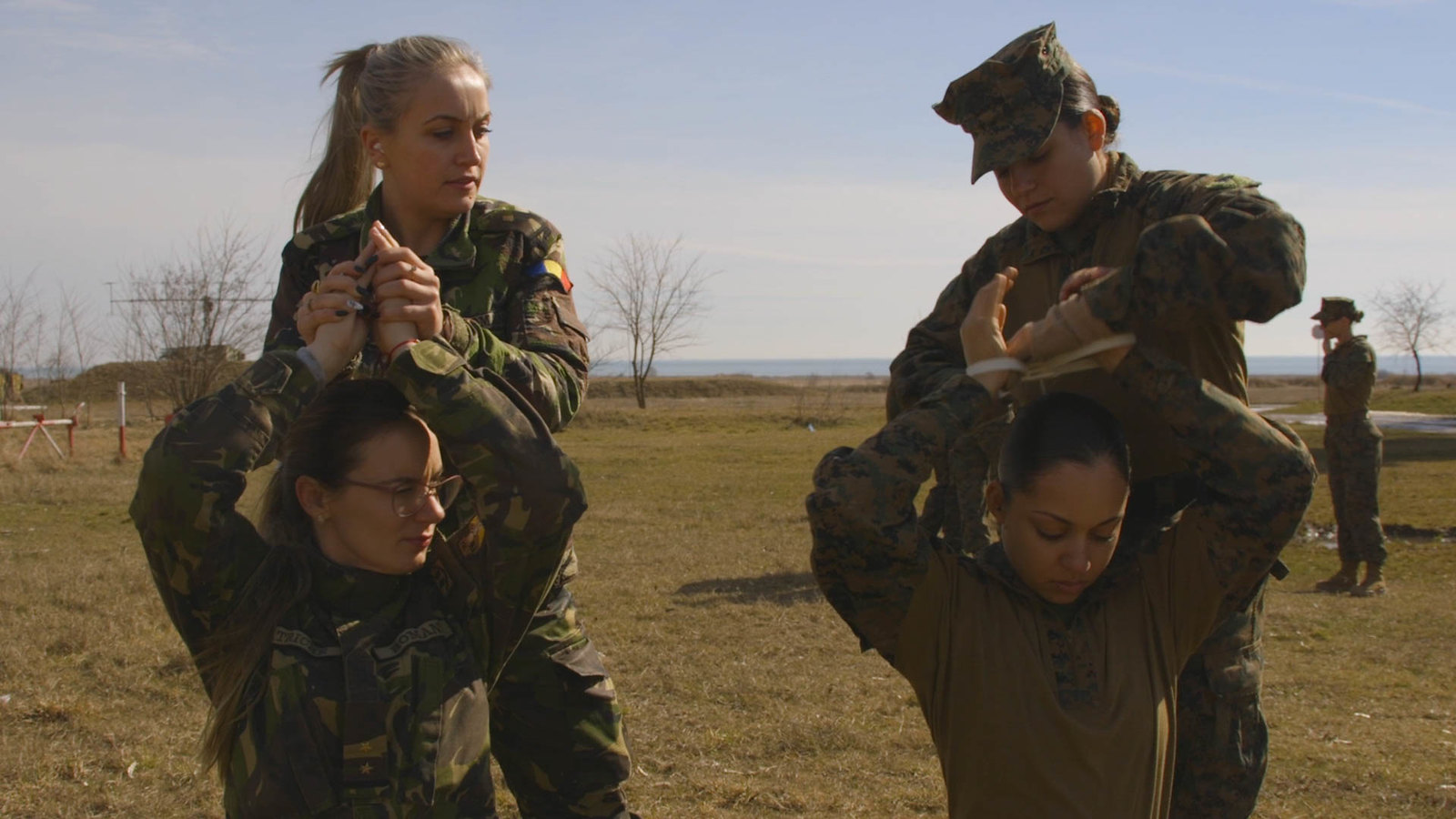CAPU MIDIA TRAINING AREA, Romania (March 9, 2018) U.S. Marines assigned to the Female Engagement Team (FET), 26th Marine Expeditionary Unit (MEU), and the Romanian FET conduct detainee handling during bi-lateral training at Capu Midia Training Area, Roman