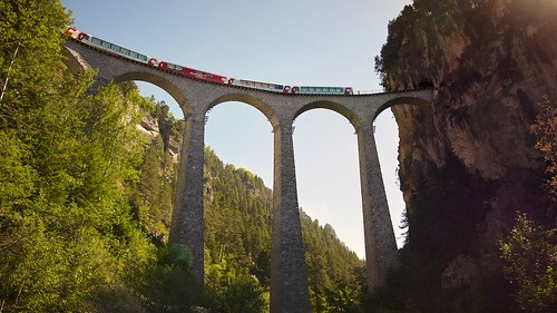 Glacier Express on the Landwasser viaduct. From Have A Swiss Travel Pass? Happy Traveling via Trains, Boats, and Land