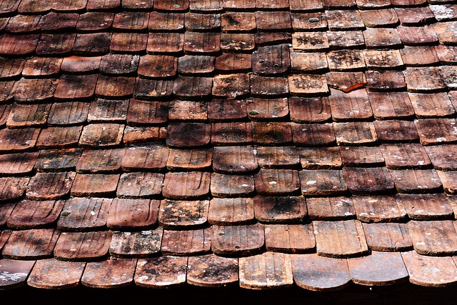 Old roof tiles on a house in Germany