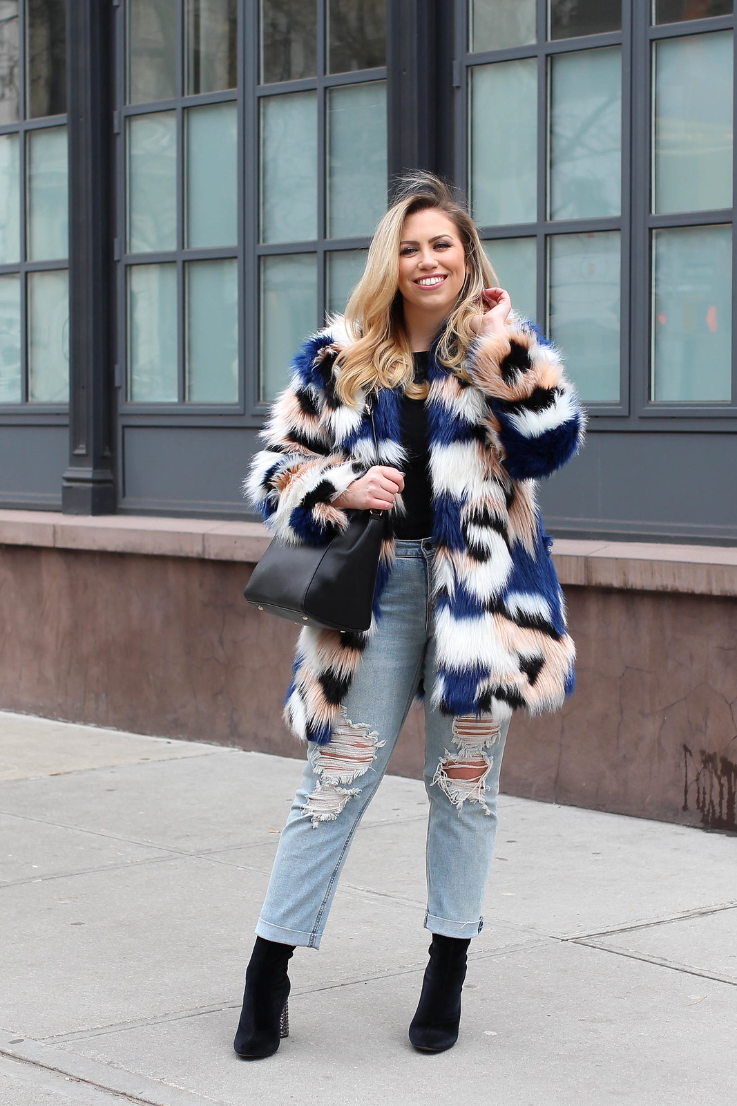 End of Winter Outfit Colorful Fur Coat Light Wash Distressed Jeans Black Sock Booties How to Get Excited by Your Own Wardrobe