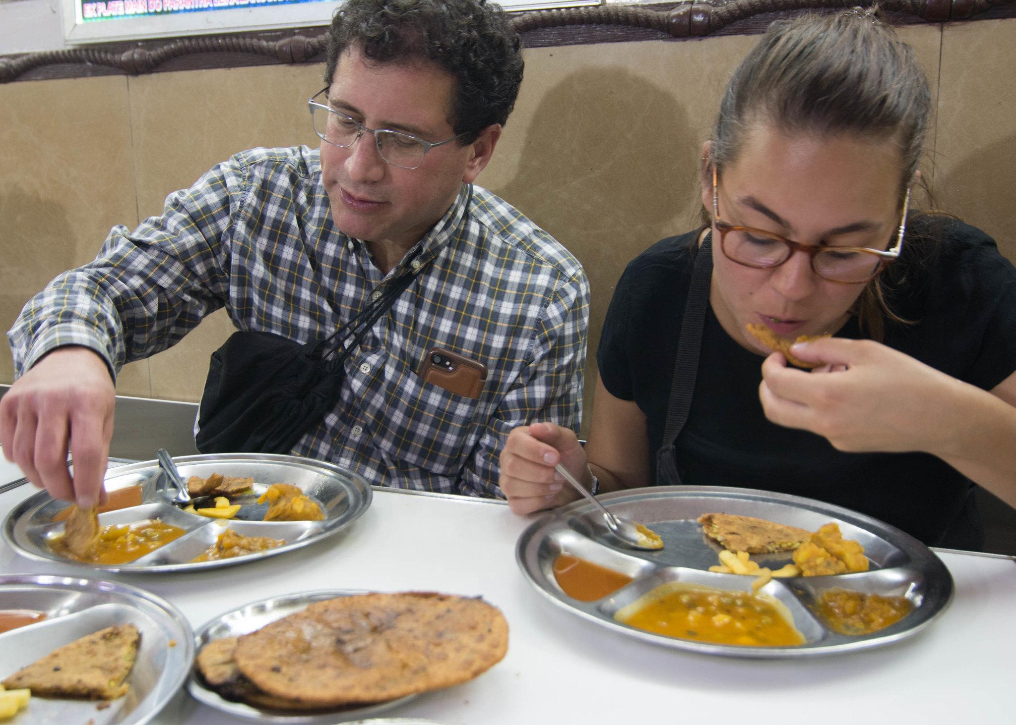 Tasting paranthas fried in ghee