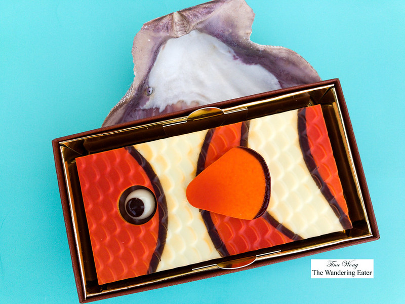 Clownfish chocolate figurine in colorful ivory chocolate, milk praliné with almonds