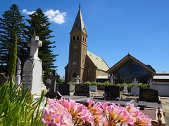 Tanunda. In the Barossa Valley. Langmeil Lutheran Church and Easter Lillies in the adjoining cemetery. The first Langmeil church built in 1846. Demolished and replaced with this fine church in 1888.