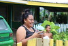 The lack of power in the aftermath of a natural disaster affects every family's daily life. Meliane Fekoko, a resident of one of the affected areas on Tongatapu Island, smiles after receiving a solar lamp. This will enable her family to continue with their normal life until the power lines are restored.   © IFRC