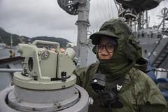 Quartermaster 3rd Class Victoria Rosario stands watch as USS Ashland (LSD 48) prepares to anchor off Sasebo for a weapons onload. (U.S. Navy/MC3 Joshua Mortensen)