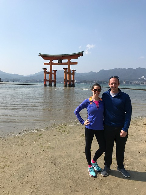In front of the torii gate during the day time