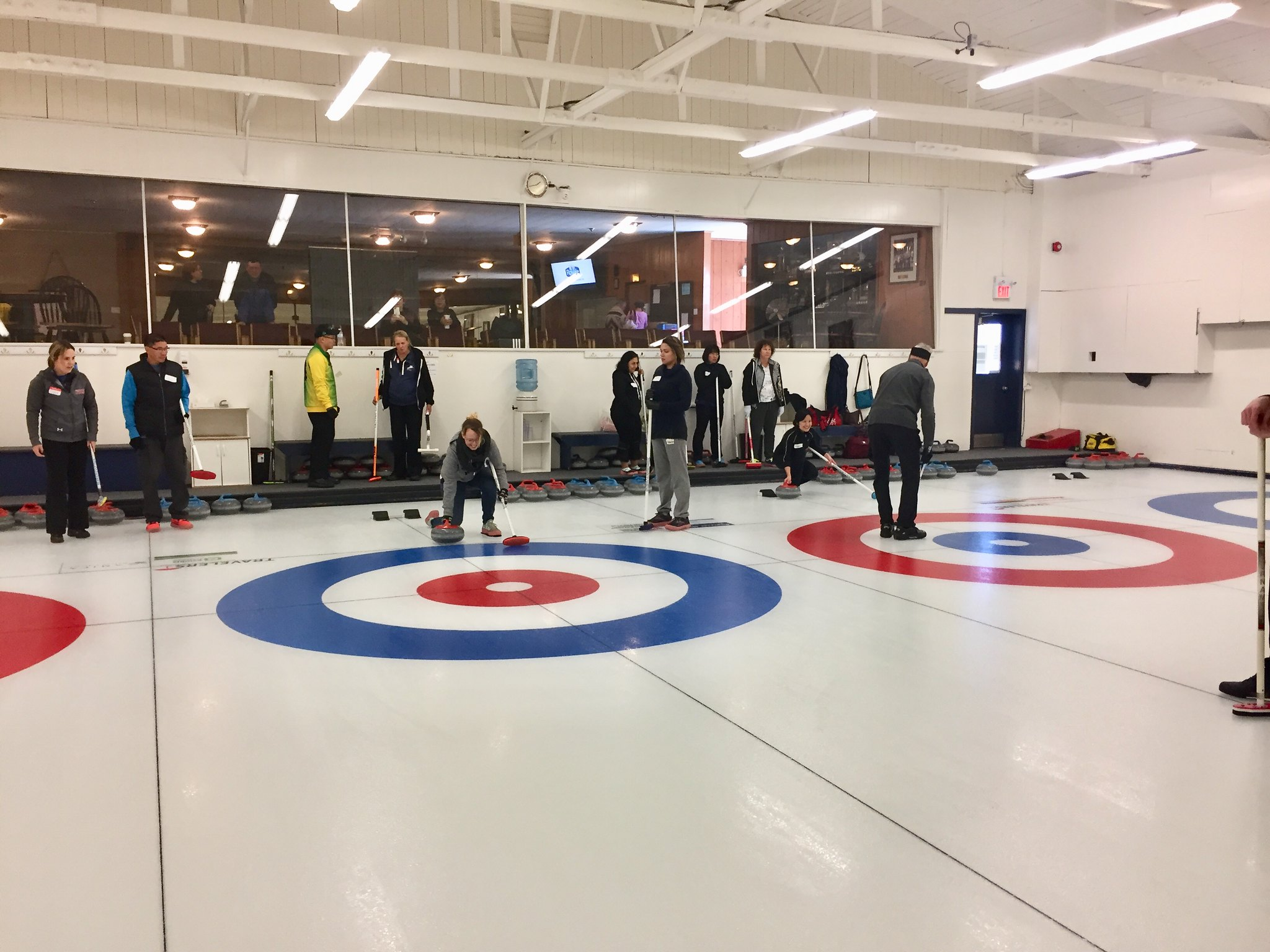 Delivering the curling stone.