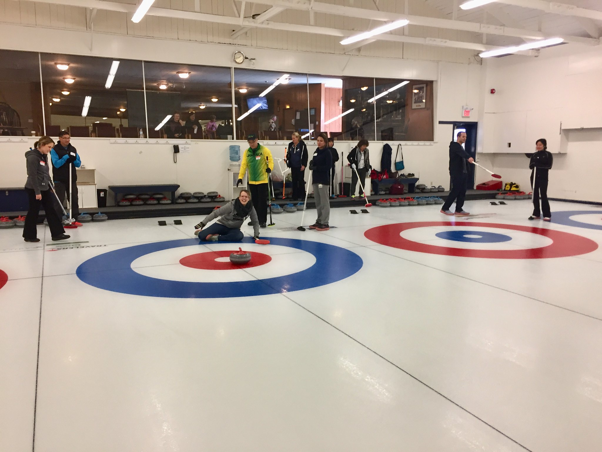 Falling over when learning to deliver the curling stone.