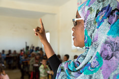 A school Headmistress addresses students in class