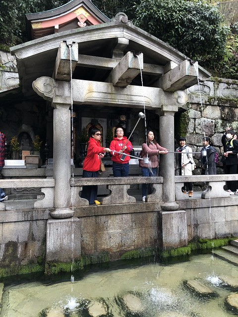 Drinking water meant to bring good luck at Kiyomizu-dera Temple
