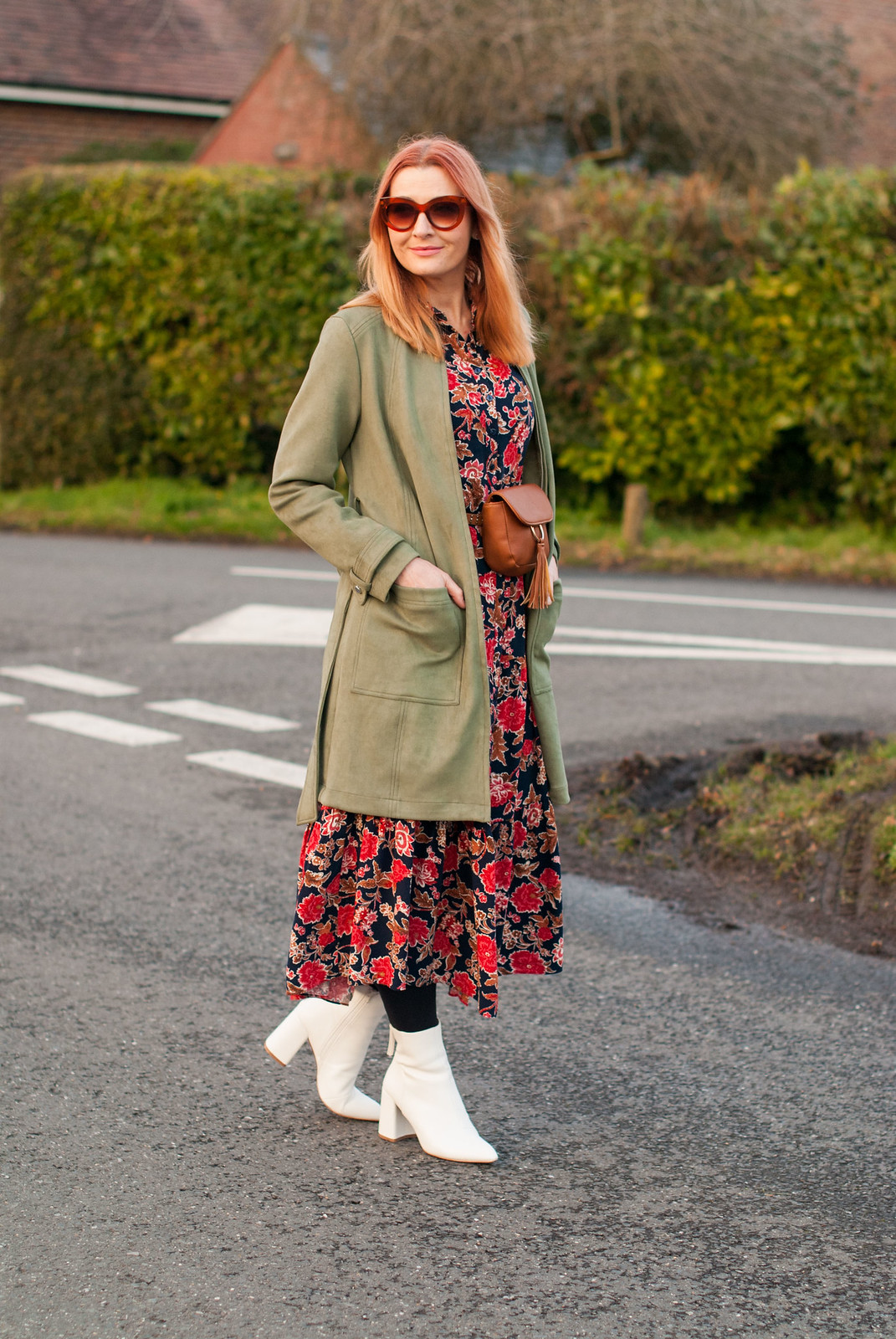 Floral maxi dress and white boots with longline khaki jacket and tan bumbag | Over 40 style fashion | Not Dressed As Lamb