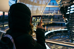 A woman taking picture inside Reichstag Dome