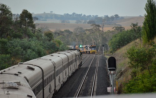 The westbound Indian Pacific passes 8253+81+81+81 as they wait to enter the single track section of the line ahead with #8938 ex Manildra.