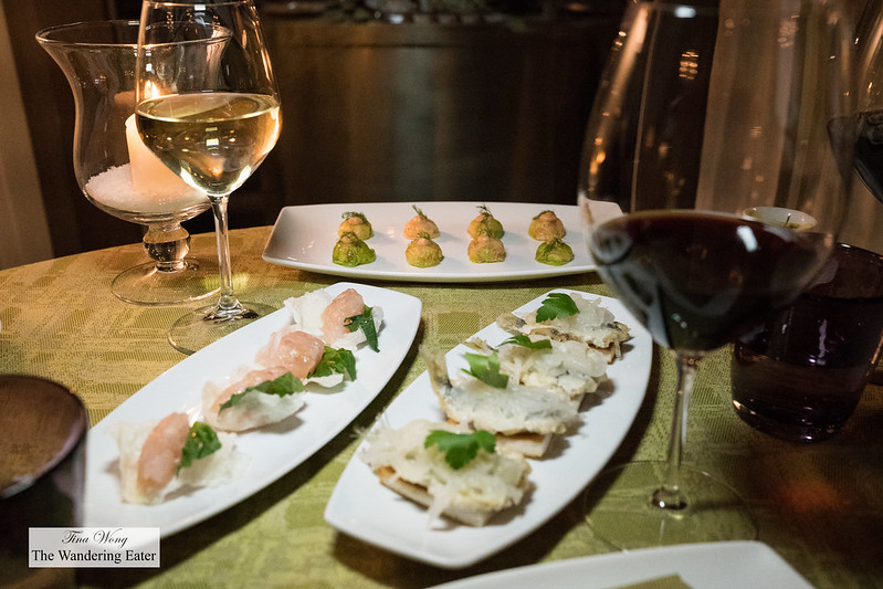 Various Venetian cicchetti - sardines in saor, lobster and ham in lettuce, branzino tartare, shiso on rice chip