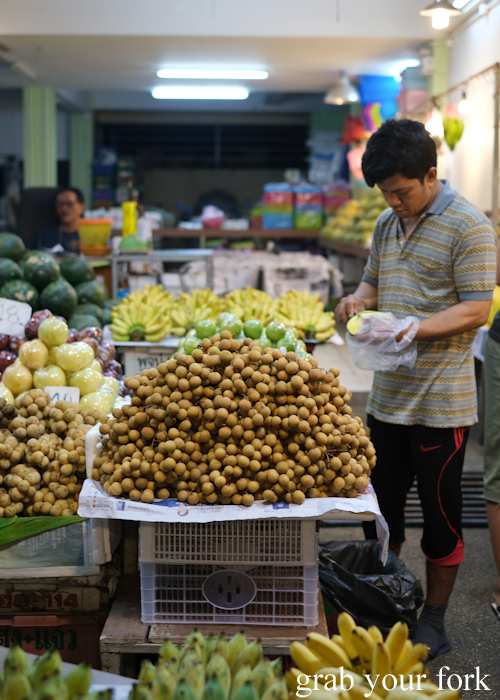 Longans and tropical fruit at a night fruit stall in Phuket Thailand