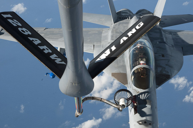 PACIFIC OCEAN (Dec. 12, 2018) An F/A-18F Super Hornet from Air Test and Evaluation Squadron (VX) 9 conducts air refueling operations over the Pacific as part of exercise Sentry Aloha. The 128th Air Refueling Squadron KC-135 Stratotanker used a boom drogue to transfer 26,000 pounds of fuel to VX-9 aircraft during the training sortie. (U.S. Air National Guard photo by Master Sgt. Mysti Bicoy)