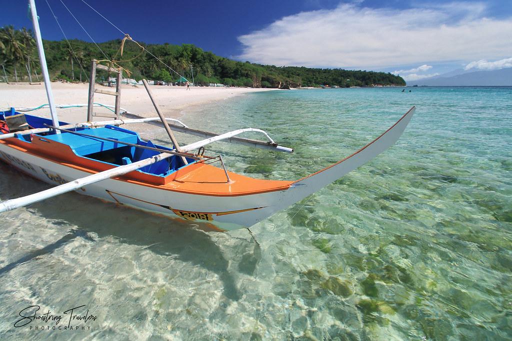 motorized outrigger boat at Masasa Beach