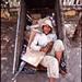 woman in a barrel in Phnom Penh