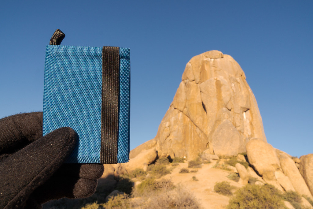 The Tom Bihn Nik's Minimalist Wallet compared to a massive rock formation know as Tom's Thumb