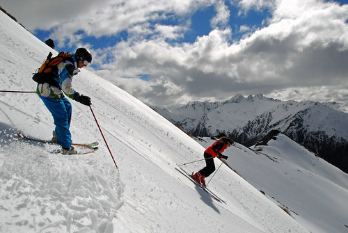 Larry's wife Cindy and son Will helicopter skiing in the Southern Alps, New Zealand.