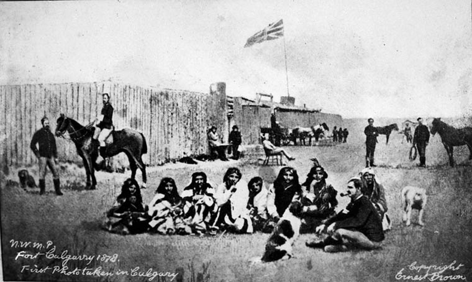 Mounted police and members of the Blackfoot First Nation at Fort Calgary, 1878. Library and Archives Canada / C-008200