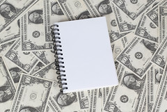 Notebook and money
