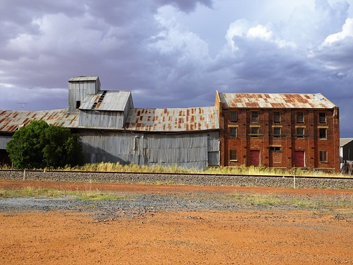 West Wyalong. Summer storm beyond the 1946 built three storey flour mill. It replaced an early 1909 flour mill which burnt down in 1943.