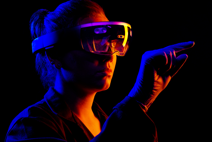 A woman wearing a pair of virtual reality goggles.