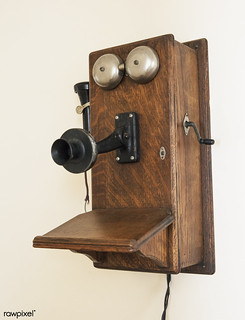 """An old-style crank telepone inside a prairie """"I house,"""" part of the Ackley Heritage Center. Original image from Carol M. Highsmith's America, Library of Congress collection. Digitally enhanced by rawpixel."""