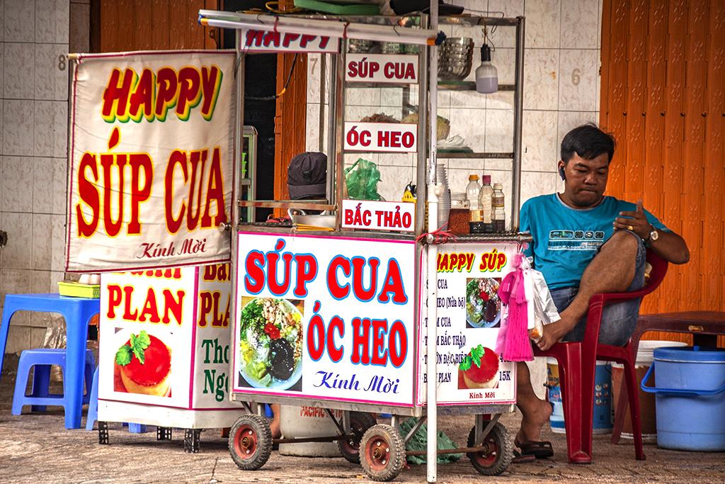 Seller of crab and pig's brain soups--Saigon