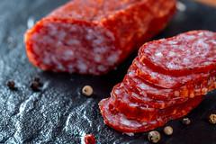 Sliced sausages on black