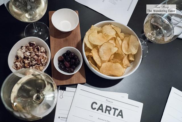 Bar snacks and Franciacorta while readin through the menu