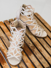 Bridal Sandals on Wooden Table