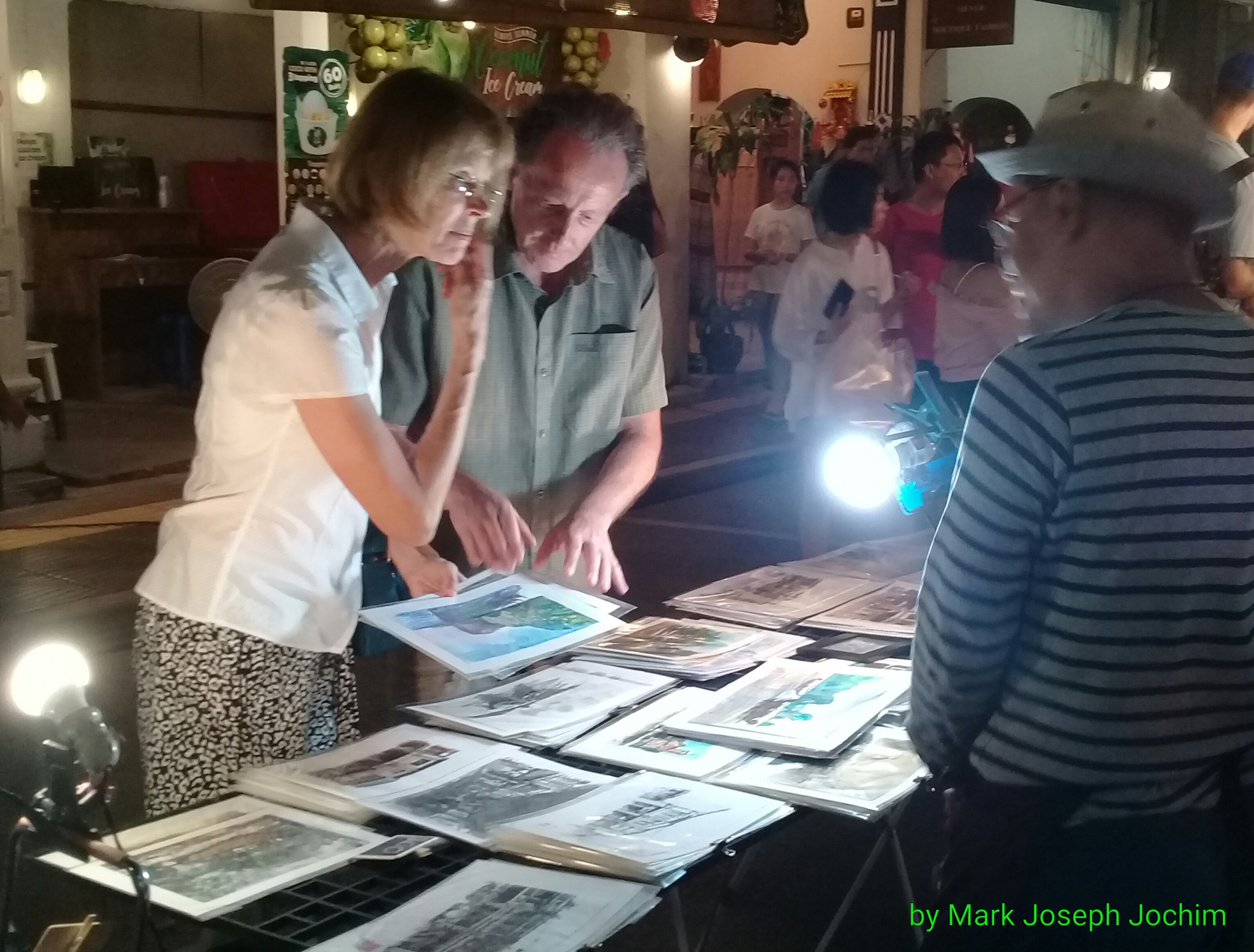 Foreign tourists buying prints at the Sunday night Walking Street known locally as Lard Yai in Phuket Old Town, Thailand. Photo taken on January 20, 2019.