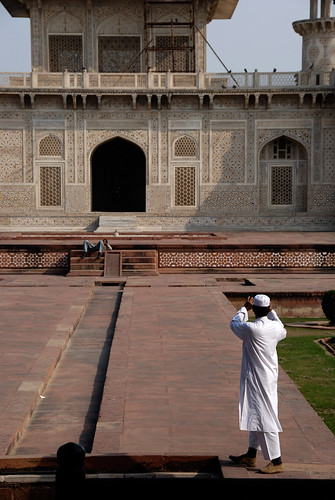 A photographer at the Baby Taj, aka Itimad-ud-Daulah, a Mughal structure built completely from marble containing the tomb of the Persian nobleman