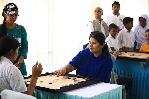 Devotees playing Carrom Board