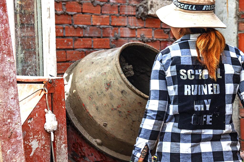 Woman on construction crew--Saigon