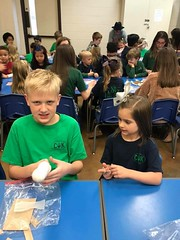 Kindergarten and 6th crafting together. They made baby Jesus and mangers