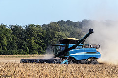 A harvester kicks up dust in a cornfield near Bridgeton in Parke County, Indiana. Original image from Carol M. Highsmith's America, Library of Congress collection. Digitally enhanced by rawpixel.