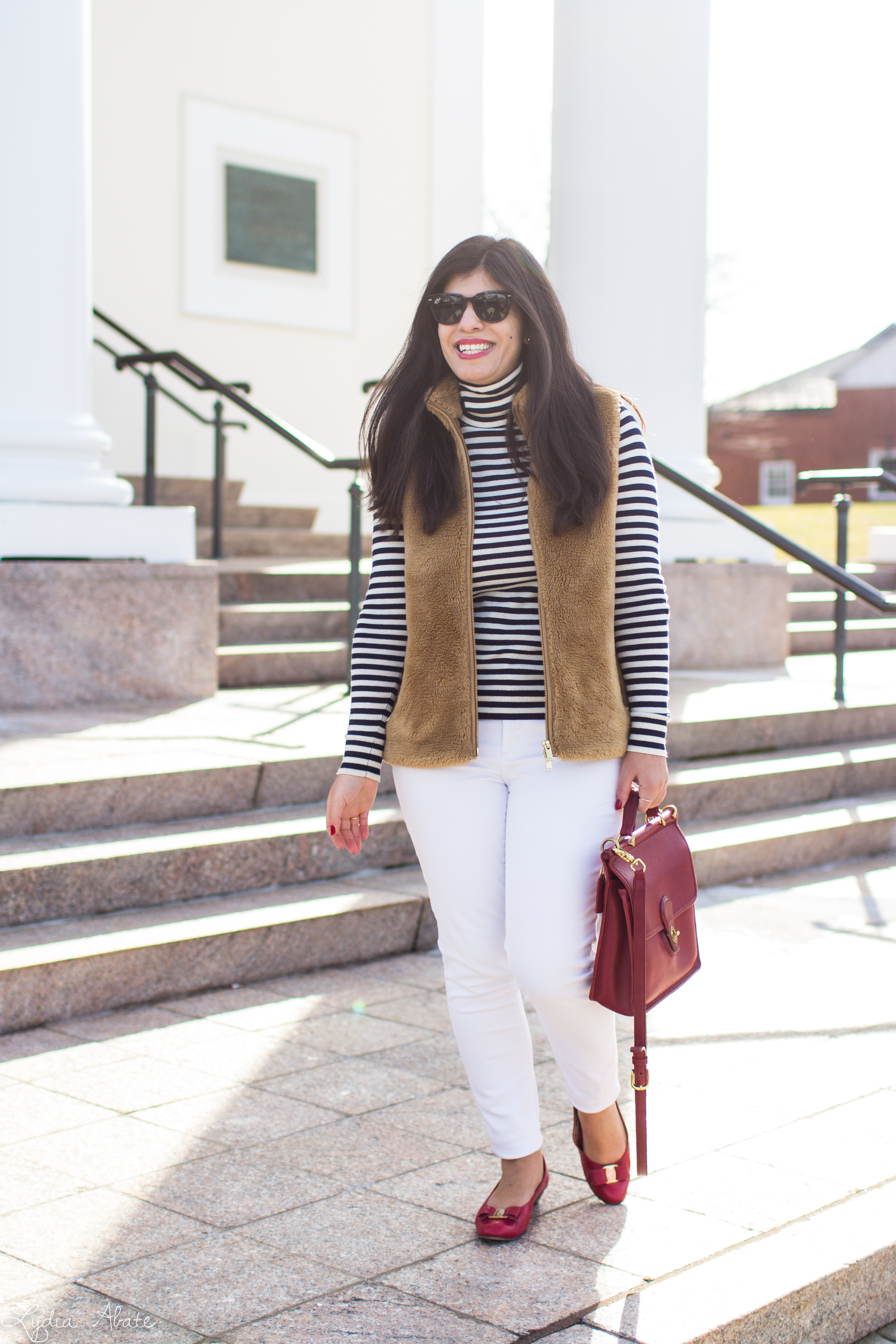 J.Crew plush excursion vest, striped shirt, white jeans, red Ferragamo bow pumps, coach bag-10.jpg