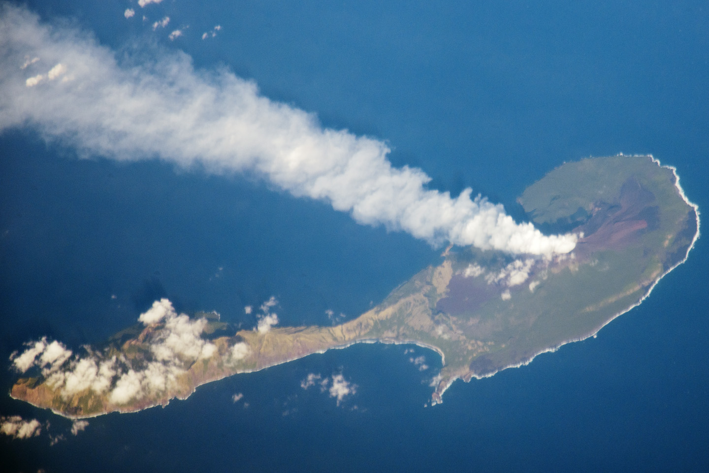 A steam plume blows south from the peak of Pagan Island's northernmost volcano in this photograph by an astronaut on the International Space Station (ISS). The ISS was located over the Pacific Ocean approximately 300 miles (480 kilometers) to the southeast of Pagan Island when the image was taken. Astronaut photograph ISS030-E-122047 was acquired on March 6, 2012, with a Nikon D3X digital camera using an effective 1200 mm lens, and is provided by the ISS Crew Earth Observations experiment and Image Science & Analysis Laboratory, Johnson Space Center. The image was taken by the Expedition 30 crew.