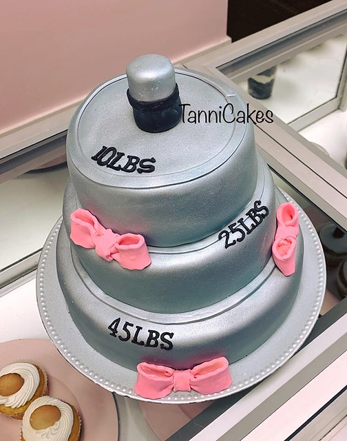 Barbells and Bows Gender Reveal Cake by TanniCakes