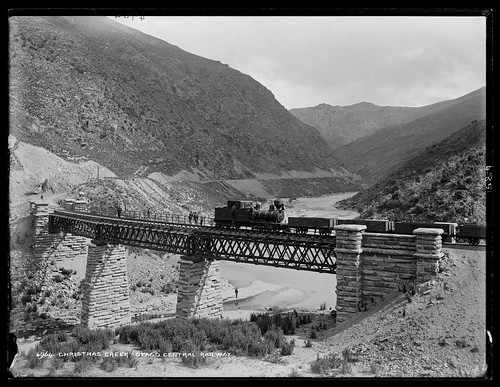 A R class 0-6-4T Single Fairlie poses on Christmas Creek bridge with a Dunedin-bound train, c.1890. From Lost Railway Journeys: New Zealand's Otago Central Railway