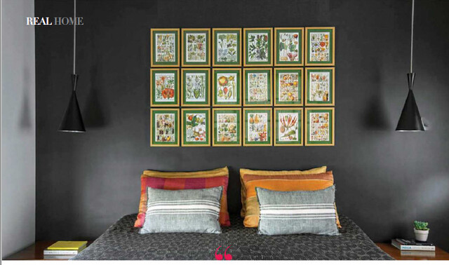 A dramatic gallery wall in bedroom in Rohit and Urmee's home
