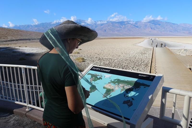 Looking at one of the informative signs at Badwater in Death Valley