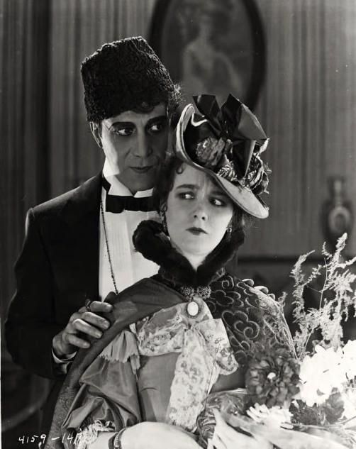 Arthur Edmund Carewe & Mary Philbin in The Phantom of the Opera - publicity still (original image damaged, modified & cropped)