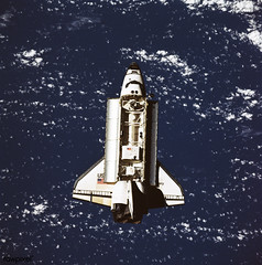 The Space Shuttle Discovery approaches Russia's Mir space station in this 70mm photograph taken from the Mir. Original from NASA. Digitally enhanced by rawpixel.