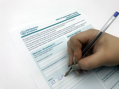 Somebody filling out a Stamp Land Duty Tax form from HMRC